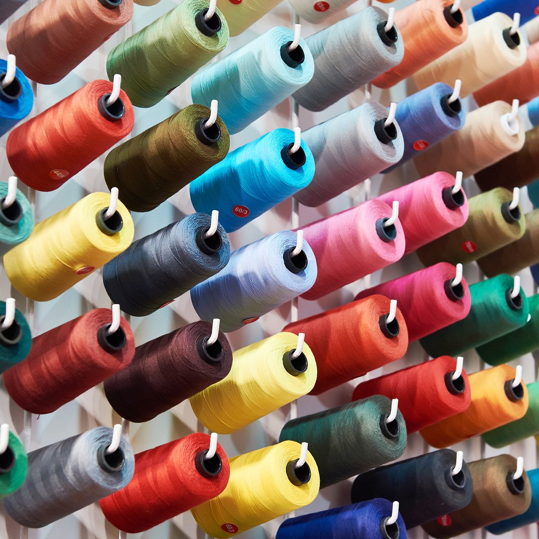 bobbins with coloured thread